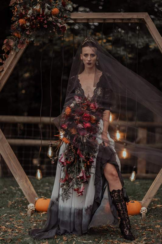 a Halloween bridal look with a black lace top, a dip dye maxi skirt, black lace tall booties and a black veil and a crown is wow