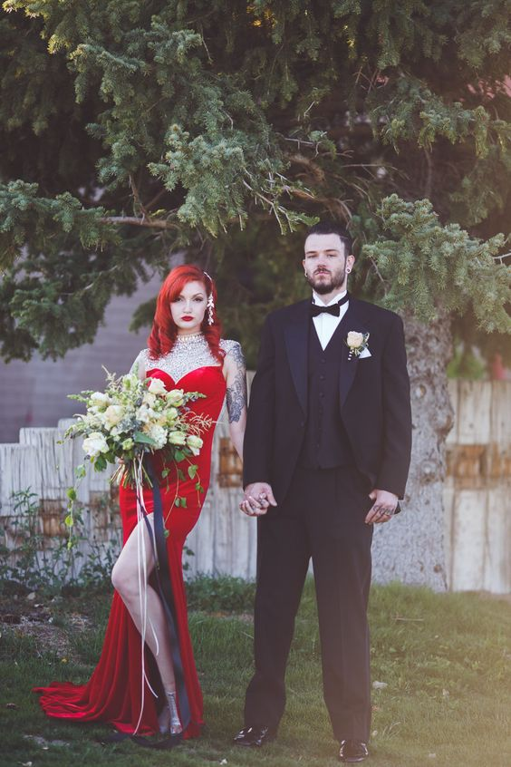 a Jessica Rabbit inspired bridal look with a red velvet sheath dress with a slit and a fully embellished neckline