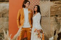 a boho fall wedding backdrop in grey and orange, pampas grass, neutral and rust blooms is idea for a fall wedding