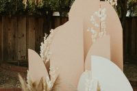 a boho fall wedding backdrop of white and blush parts and pampas grass is a pretty solution not only for the fall but also for spring