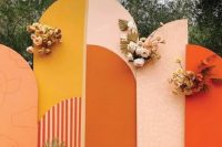 a bold fall wedding backdrop in mustard, blush, orange and white, with pastel and neutral blooms and dried fronds plus pampas grass