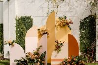 a bright boho fall wedding backdrop in blush, mustard and rust, with bold blooms and greenery is a cool idea to rock