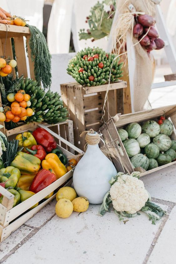 a farm fresh veggie station with olive oil and some dips is an amazing idea for a farmhouse or backyard wedding