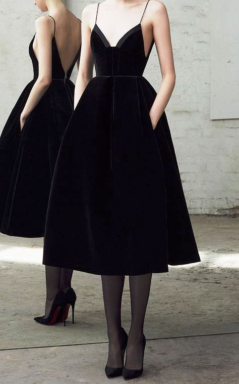 a gorgeous black velvet A-line midi bridesmaid dress with a deep neckline, an open back and a full skirt with pockets