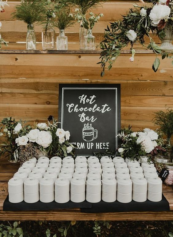 a hot chocolate bar will keep your guests cozy and happy, especially if it's an outdoor wedding