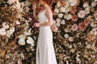 a jaw-dropping fall wedding backdrop of blooms, fresh and dried ones and dried leaves is a fantastic idea to rock