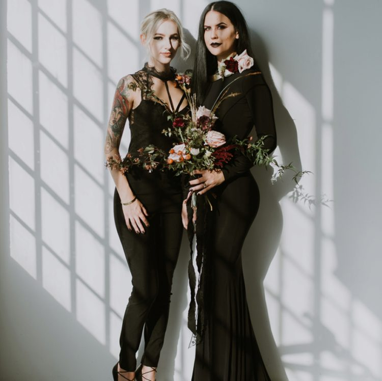 a mermaid bridesmaid gown with long sleeves and a jumpsuit with lace details on top for a modern Halloween wedding