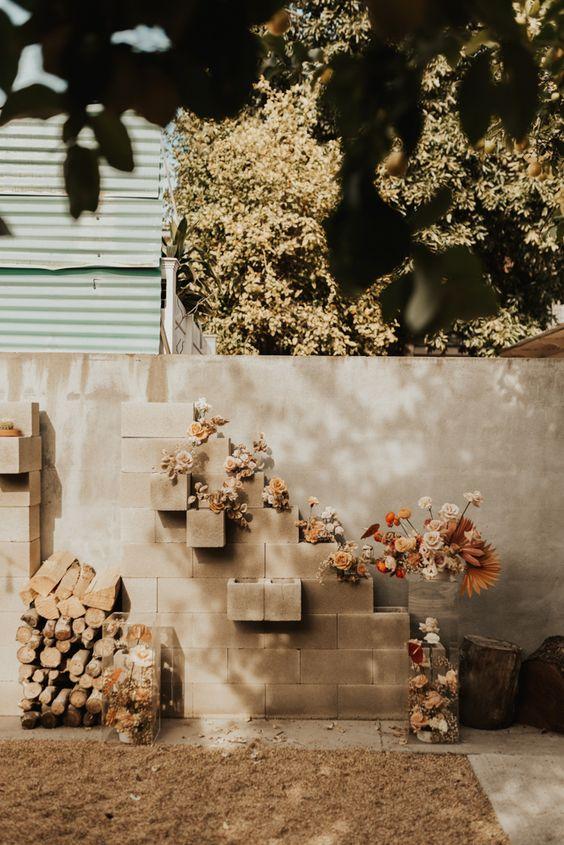 a stylish backyard fall wedding backdrop