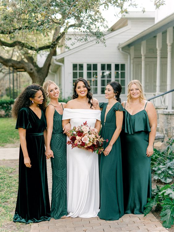 beautiful mismatching green and dark green bridesmaid dresses are very chic and beautiful for a fall wedding in greens