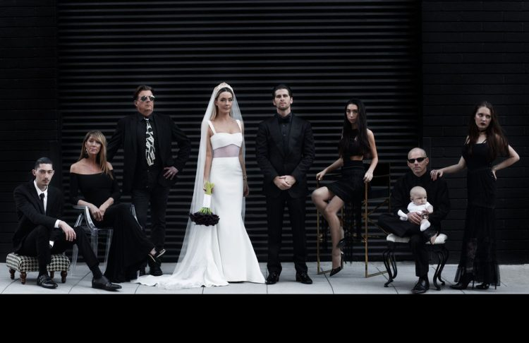 bridesmaids wearing mismatching black dresses of lace and plain fabric, with black shoes for a modern Halloween wedding