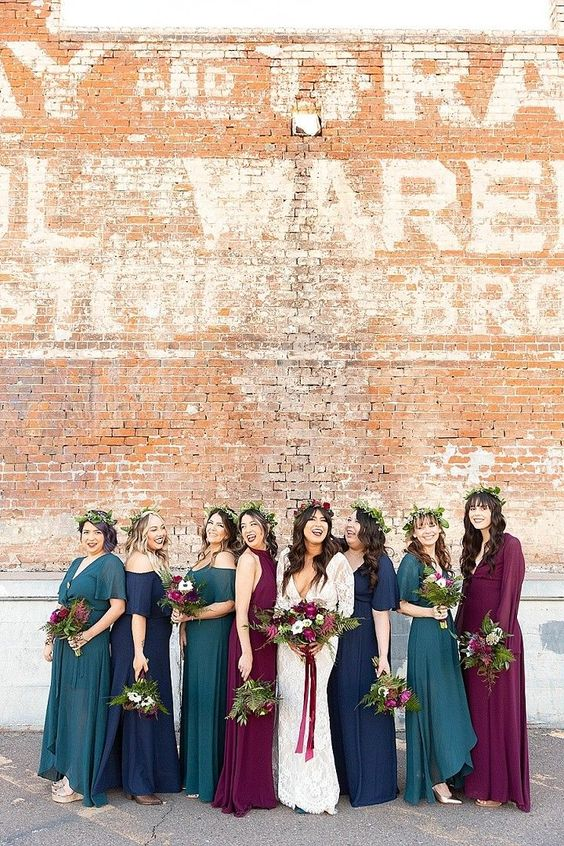 bright teal, navy, purple bridesmaid dresses with mismatching designs are perfect for a bold and jewel-toned fall wedding