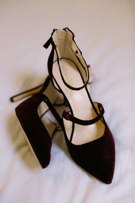 burgundy velvet strappy shoes with high heels are a very beautiful and deep toned idea for a modern Halloween bridal look with a refined touch