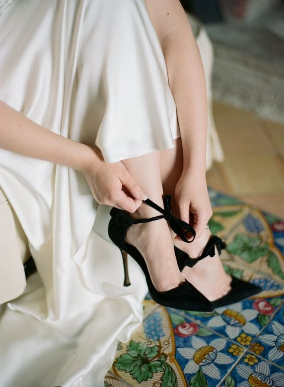 chic black velvet wedding heels with little bows to add gorgeousness and elegance to your outfit, whether it's a Halloween wedding or not