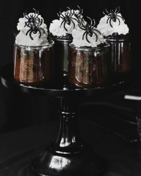 chocolate souffle with white frosting and spiders on top is a great dessert idea for a Halloween bridal shower or wedding