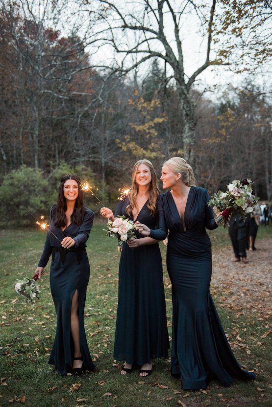 elegant mismatching navy bridesmaid maxi dresses with various designs for a Halloween wedding