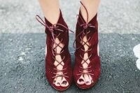 fantastic burgundy suede lace up booties are a fantastic idea for a fall or Halloween bride and they will make a statement