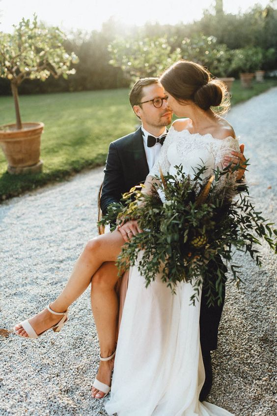 go for a greenery wedding bouquet and feathers to make your wedding look more special