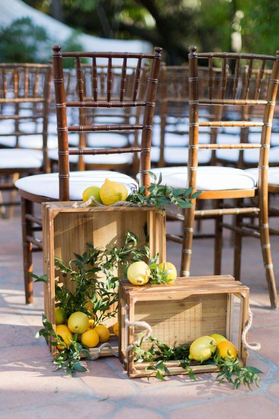 highlight your wedding ceremony space with crates with greenery and lemons to remind where you are tying the knot