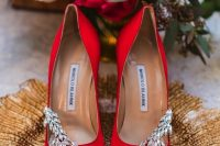 hot red embellished shoes are a stylish solution to make a statement with color at a Halloween wedding and can match many other bridal looks