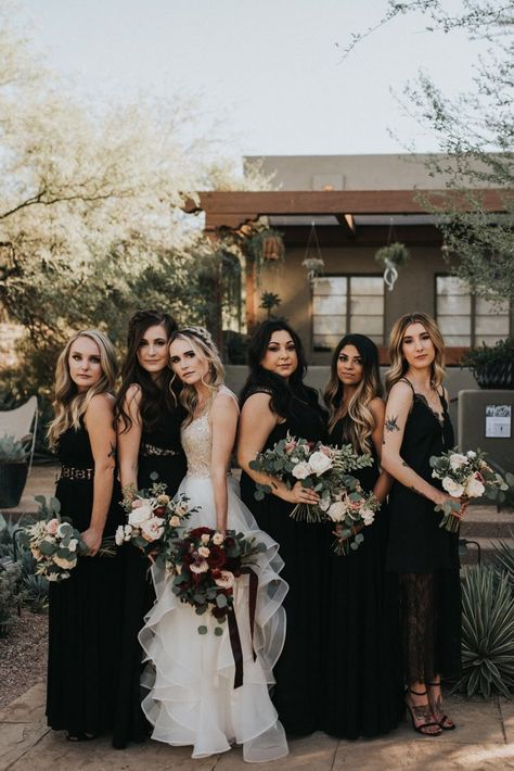 mismatching black maxi and midi bridesmaid dresses of lace and plain fabric and black shoes for Halloween