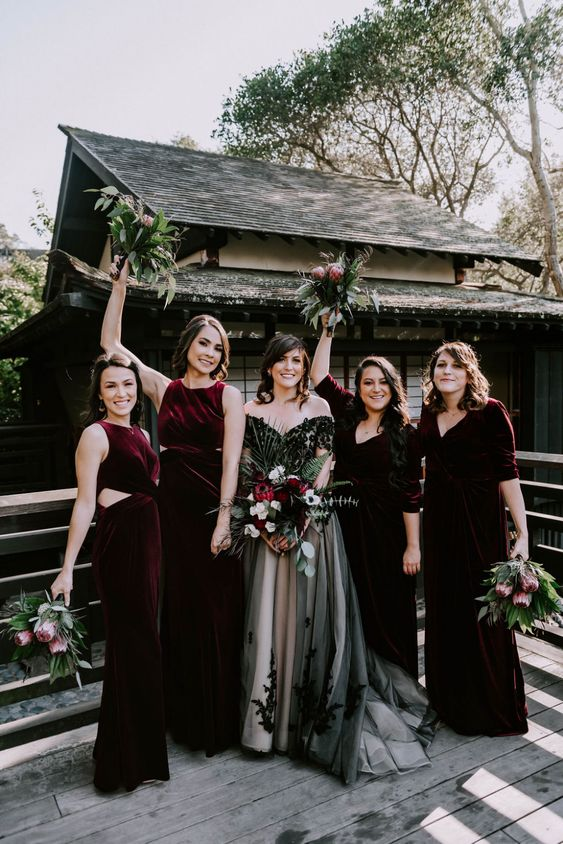 mismatching burgundy velvet maxi bridesmaid dresses are fantastic for a fall, winter or Halloween wedding