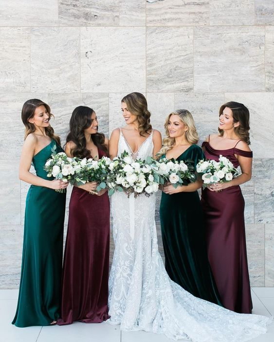 mismatching dark green and purple maxi bridesmaid dresses are very chic and lovely for a fall wedding in any style