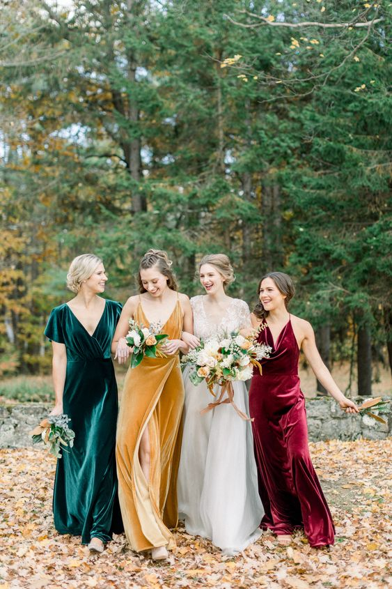 mismatching jewel tone bridesmaid dresses of velvet - an emerald, burgundy and mustard one are fantastic for a fall wedding in bright shades