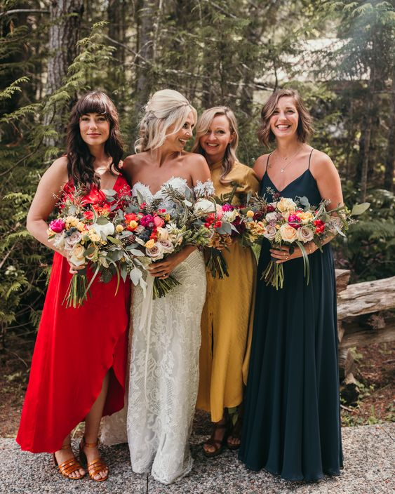 mismatching jewel tone midi and maxi bridesmaid dresses in red, mustard and dark green are amazing for a bright fall wedding