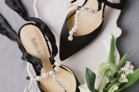 refined black shoes with pearl straps and silk ribbons are a very beautiful solution not only for a Halloween but for many other brides, too