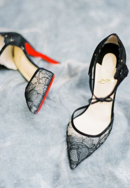 sheer black lace shoes with little bows, red bottoms and heels are a very refined and gorgoeus solution for a Halloween bride