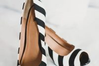 striped black and white wedding shoes with peep toes are great for a Tim Burton wedding or for a witch-inspired look