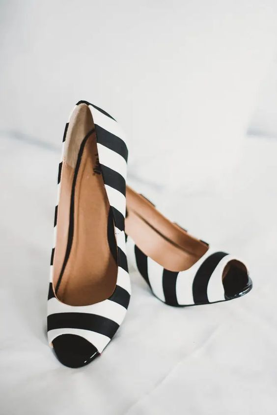 striped black and white wedding shoes with peep toes are great for a Tim Burton wedding or for a witch inspired look