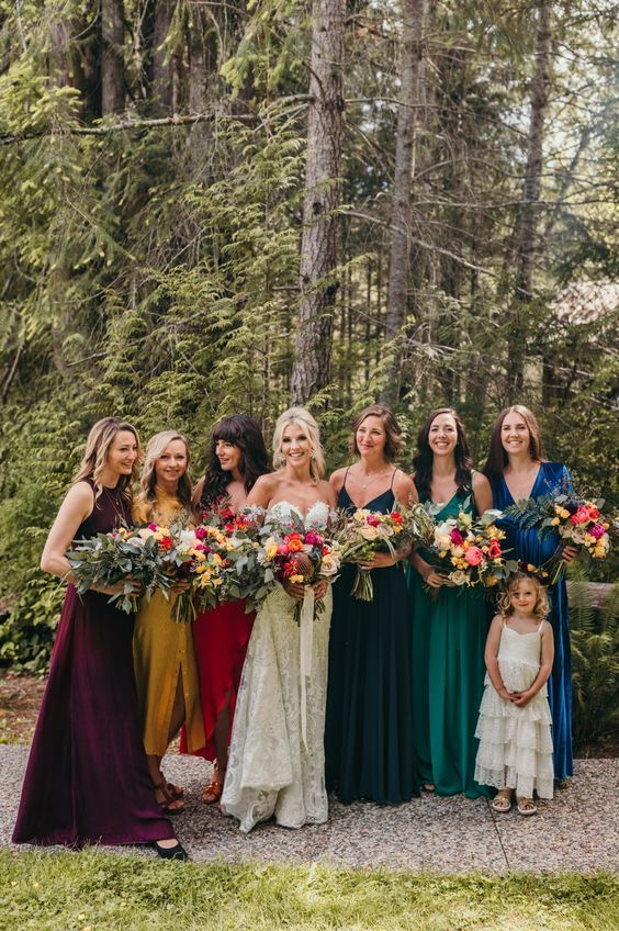 super bold jewel tone maxi bridesmaid dresses in deep purple, mustard, red, navy and emerald plus electric blue are gorgeous for the fall