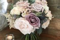 a beautiful wedding bouquet in muted tones – blush, mauve, ivory and with greenery