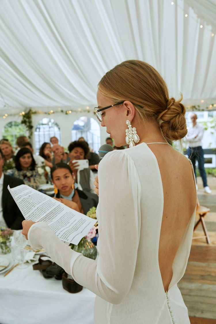 a bride rocking statement pearl earrings to highlight her minimalist wedding look
