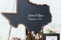 a chalkboard state silhouette with framing that is to be filled with wooden hearts with wishes is a cool idea