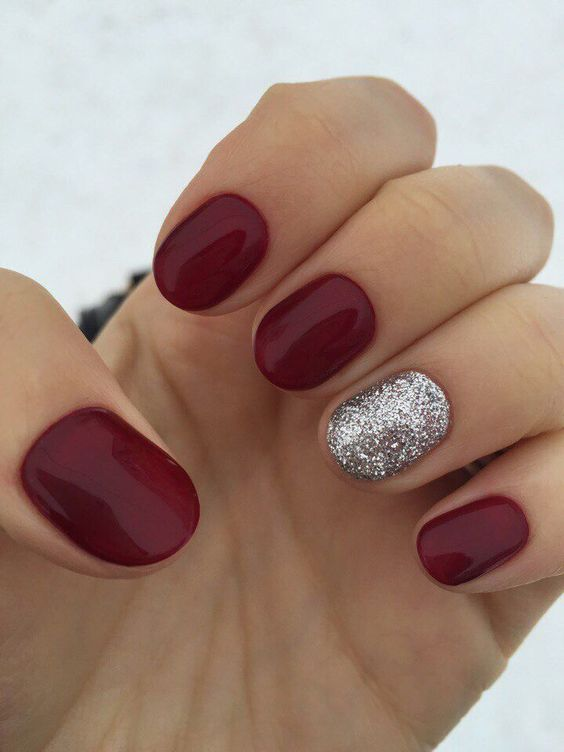 a classic red manicure spruced up with a silver glitter accent nail is perfect for Christmas