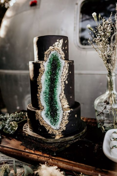 a glam black and emerald geode wedding cake with gold leaf is a stylish and cool idea
