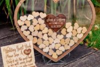 a glass heart with framing is to be filled with mini plywood hearts that will be signed by the guests