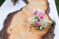 a live edge wood piece with your wedding date is to be signed by the guests and then can become an artwork
