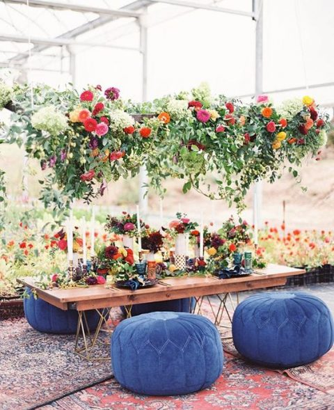 a lush greenery and bright bloom wedding decoration plus matching centerpieces