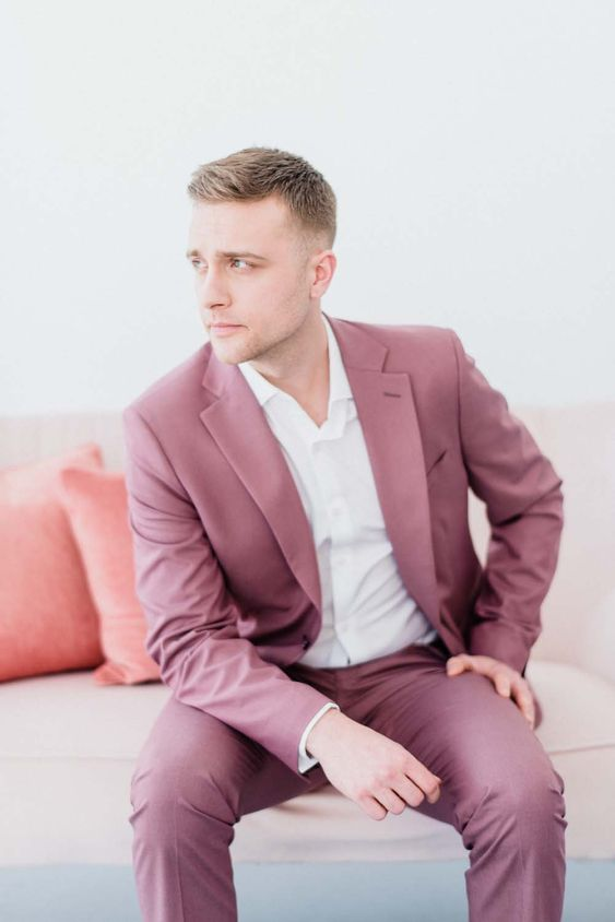 a mauve groom suit with a white shirt create a fresh and chic look suitable for a summer or fall wedding