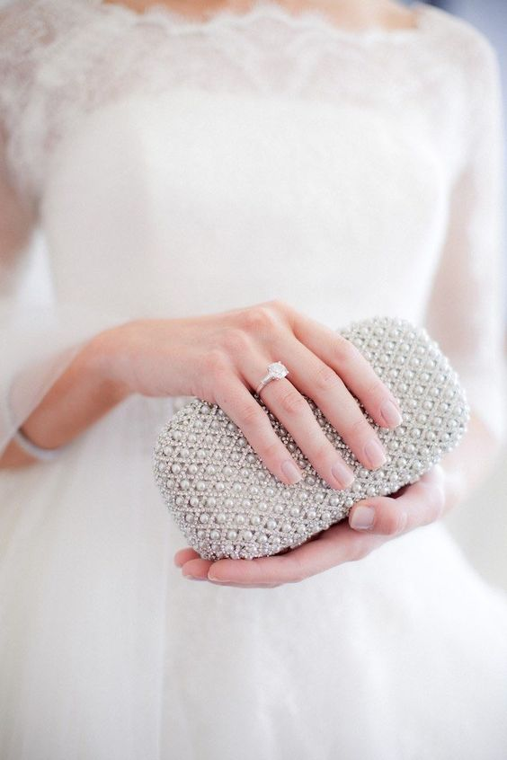 a modern small rhinestone and pearl clutch will contain everything you need at the wedding
