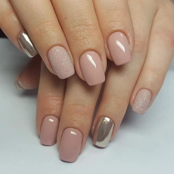 a nude manicure with a touch of glitter and silver nails for those who insist on a modern take on classics