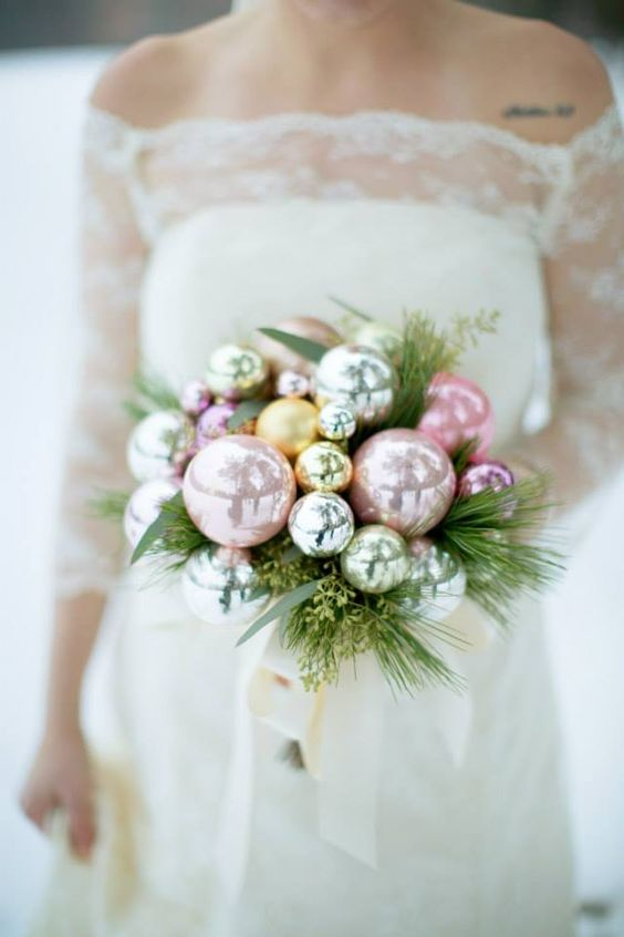 a pastel Christmas wedding bouquet with evergreens, foliage is a very tender idea for a winter wedding