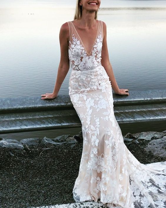 a romantic sheath nude lace wedding dress with thick straps and a deep neckline plus a train looks stunning