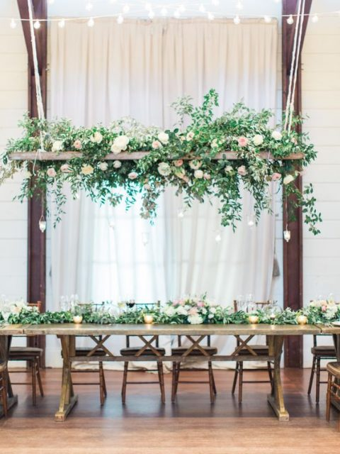 a rustic decoration with blush and white blooms and cascading greenery