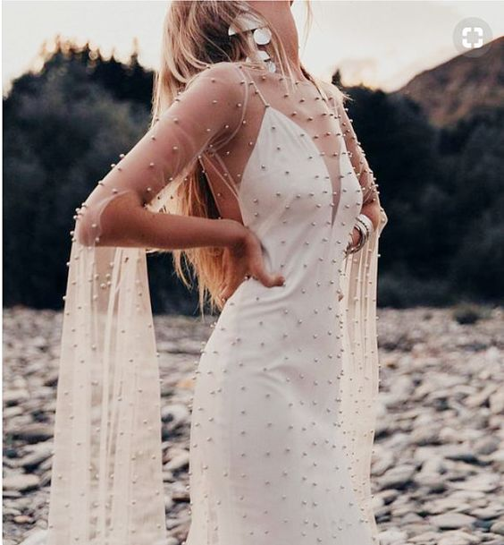a sheer pearl overdress with long bell sleeves will make any bridal look much more special