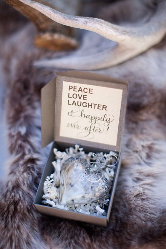 a silver heart ornament in a box is a cute and chic winter or holiday wedding favor