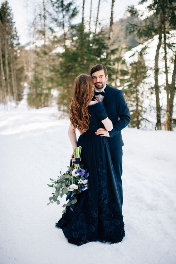 a stunning navy off the shoulder wedding dress with a lace applique skirt
